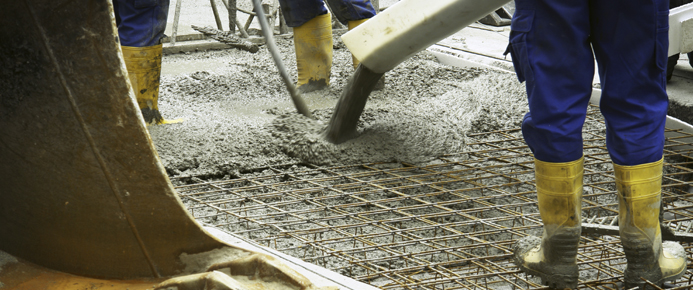 Workers placing concrete on a construction site